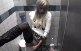 Soloing amateur blonde stimulates her pussy in the local toilet